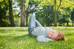 Woman Takes a Nap in a Park Stock Photos