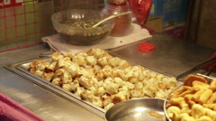 Dumplings cooking at vendors in Lehua Night Market Stock Footage