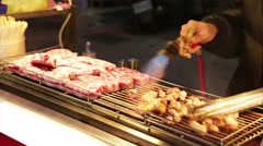 Stock Video Footage of Vendors braising beef with blowtorch Night Market