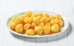 Boiled potatoes on oval plate - stock photo