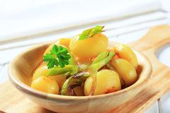 Bowl of potatoes with leek - stock photo