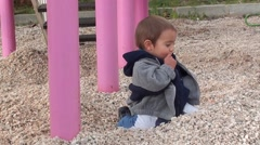 Stock Video Footage of Charismatic toddler plays on gravels