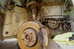Wheel housing with visible break disc and suspension - stock photo