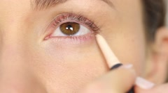 Highlighter pen for eye corners - stock footage