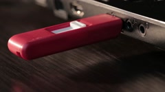 Computer red USB flash drive disk connected melted by high temperature in laptop - stock footage