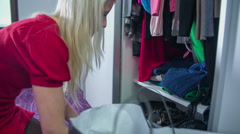 Folded clothes in to the closet - stock footage