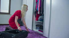 Stock Video Footage of From a closet to the suitcase