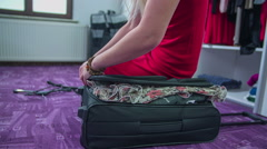 Woman zipping the full suitcase Stock Footage