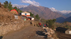 Road with travelers at Annapurna region in Nepal Stock Footage