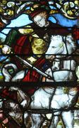 stained glass window in the church of Triel - stock photo