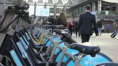 Canary wharf, people walking past bikes Stock Footage