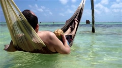 Man enjoing an hammock in the water Stock Footage