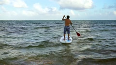 Man surfing  on paddle board - stock footage