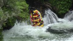 Tourists white water rafting down waterfall, Rotorua, New Zealand - stock footage