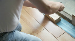 Fitting laminate flooring to ledge Stock Footage