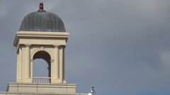 Top of building with bell tower and timelapse clouds Stock Footage