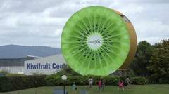 Tourists at Kiwi fruit 360 factory sign, Te Puke, North Island, New Zealand Stock Footage