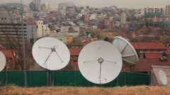 Old sattelite antennas on ground - stock footage