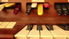 PIANO-ORGAN KEYS (Dolly Move) - Dolly right along vintage organ Stock Footage