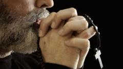 Religion pray mouth rosary faithful Stock Footage