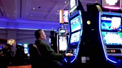 One side of people playing slot machine Stock Footage