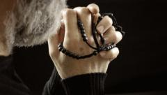 Religion pray rosary beads believer - stock footage