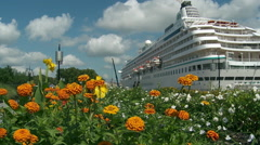 Bordeaux -  Port of Bordeaux Cruise Ship Docked with Marigolds in Foreground Stock Footage