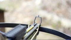 Firing crossbow slow motion fire Stock Footage