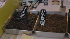 Tsukiji Fish market - different dried foods Stock Footage