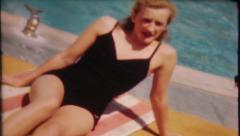 1838 - pretty blonde sunbathing by hotel pool - vintage film home movie Arkistovideo