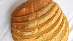 Sliced loaf of bread slowly rotating on white Stock Footage
