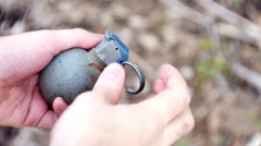 Throwing grenade throw bomb explosive Stock Footage
