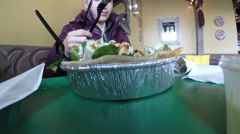 Woman eating a mexican salad in restaurant Stock Footage