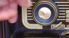 Hand Raising volume on Vintage fashioned radio. Stock Footage