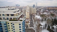 Aerial view to cityscape with wide avenue, residential buildings Stock Footage