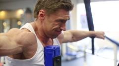 Brown hair man bodybuilder is doing shoulders exercises Stock Footage