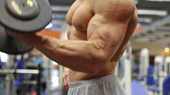 Muscular torso and hands with dumbbells of man standing Stock Footage