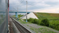 View on railway and bridge from moving train, motion blur. Stock Footage