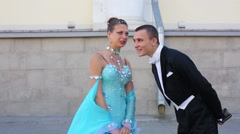 Beautiful young pair of dancers are talking at the Graduate-2013 Stock Footage