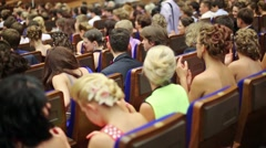 Back view of spectators which applauding at Graduate-2013. - stock footage