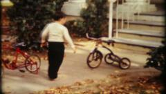 1842 - boy waves goodbye to tricycle & rides bicycle - vintage film home movie Stock Footage
