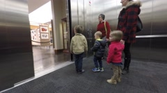 Family strolling through the Bean life science museum time lapse Stock Footage