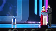 Robot is walking on stage in the State Kremlin Palace Stock Footage