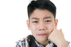 Asian cute boy sad and crying Stock Photos