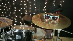 Black and gold drum-bass set in studio with garlands. - stock footage