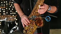 Close up view of the hands saxophonist playing a saxophone. Stock Footage