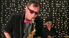 Saxophonist and drummer are playing in the studio. Stock Footage