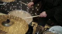 Close-up view of hands playing drum set in a night club. Stock Footage