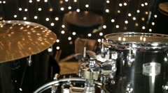 Close up view of the drum-set in studio with garlands. - stock footage
