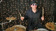 Drummer with glasses and in hat plays drum set at studio. Stock Footage